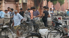 Newspaper bicycle distribution center in Amritsar, India Stock Footage