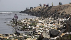 Man searches items to recycle at coastline Chennai, poverty India Stock Footage
