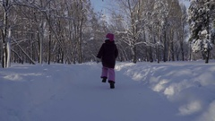 Footage Girl running in the winter park. Steadicam shot Stock Footage