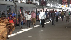 Arriving commuter train Mumbai, passengers exit carriage, India infrastructure Stock Footage