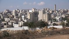 Establishing shot of an Arab neighborhood in Hebron in the West Bank Stock Footage