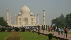 Crowds of people visit the Taj Mahal, popular tourist destination in India Stock Footage