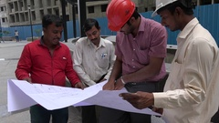 Indian engineers discuss the building of a new apartment complex Stock Footage