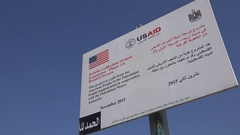 USAID sign in Jericho in the West Bank (Palestinian Territories) Stock Footage