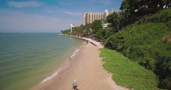 Pullback Drone Shot Along Royal Cliff Beach in Pattaya, Thailand Stock Footage