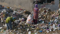 Women look for things to recycle at a garbage dump in Jaipur, India Stock Footage