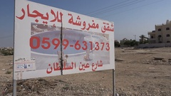 Advertising sign for luxury homes in Jericho in the West Bank Stock Footage