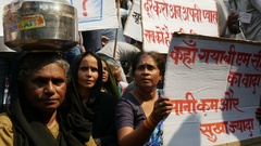 Women protest against water shortages in a suburb of Mumbai in India Stock Footage