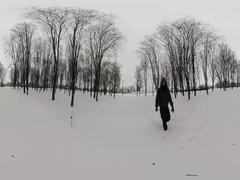 360Vr Video Man Walks by Snow Holding Camera Filming Wintry Park Bare Branch Stock Footage