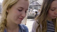 Young Women Enjoy Eating Belgian Waffles In Bruges, Belgium Stock Footage