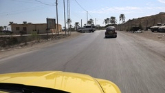 Driving behind a classic Volkswagen Beetle in Jericho in the West Bank Stock Footage