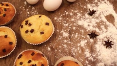 Freshly baked muffins with chocolate rosy slices sprinkled with powdered sugar Stock Footage