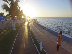 Jogging young woman excersising by the beach Stock Footage