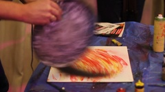 Painter drying pattern with hairdryer during spray art Stock Footage