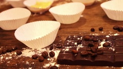 Female hand puts Raw dough for muffins in paper bakeware Stock Footage