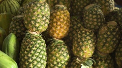 Pineapple in the fruit market Stock Footage
