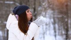 Winter girl blowing snow. Beauty Joyful Teenage Model Girl having fun in winter Stock Footage