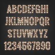 Font. Typeface with light bulbs. Shiny letters and numbers Stock Illustration