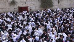 Jewish worshipers at Western Wall, Jerusalem Israel holy land Stock Footage