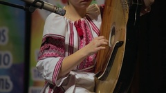 Girl in ethnic dress playing ethnic instruments Stock Footage