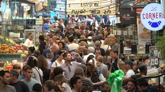 Large crowds of people walk through popular market in Jerusalem, Israel Stock Footage