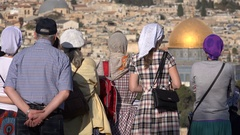 Conservative Christian pilgrims look out over Jerusalem skyline, Israel Stock Footage