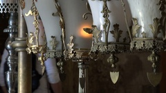 Lamps inside the Church of the Holy Sepulchre in Jerusalem Stock Footage
