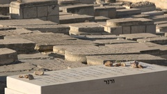 Closeup of tombs at a Jewish cemetery on the Mount of Olives in Jerusalem Stock Footage