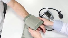 Closeup of sphygmomanometer being used of woman doctor Stock Footage