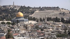 Muezzins call for prayer over the old city of Jerusalem in Israel Stock Footage