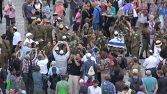 Young Israel Defense Forces pose for photos at Western Wall Jerusalem Stock Footage