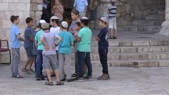 Jewish Orthodox school kids prepare to play soccer in old city Jerusalem Stock Footage