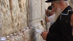 Israel religion, Jewish people pray recite Torah at Western Wall in Jerusalem Stock Footage