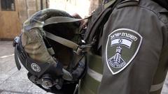 Closeup badge and helmet of Israeli soldier, army patrol in Jerusalem Stock Footage