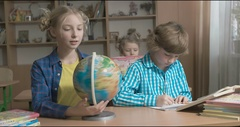 Children learning and doing homework in school classroom Stock Footage