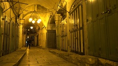 Jewish Orthodox man walks through mysterious alleys old Jerusalem at night Stock Footage