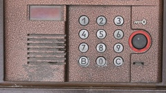 Person opening door using a numeric code of access Stock Footage