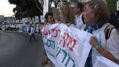 Protesters hold Hebrew banners during peaceful demonstration in Israel Stock Footage