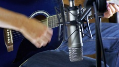 Musician Recording Acoustic Guitar in Microphone on the Home Studio Stock Footage