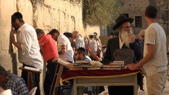 Religious Jews recite texts from the Torah at the Western Wall in Jerusalem Stock Footage