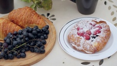 Breakfast Pastries With Tea and Grapes on the Balcony Stock Footage