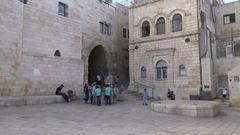 Orthodox Jewish kids on a break from school in old center of Jerusalem Israel Stock Footage