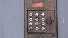 Person pushing buttons on the panel of intercom Stock Footage