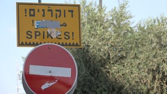 Warning sign, forbidden to enter, spikes, security measure in Jerusalem Israel Stock Footage