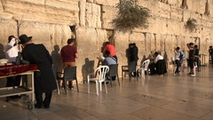 People recite texts from the Torah at the Western Wall in Jerusalem Stock Footage