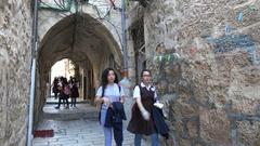 School kids walk in narrow alleys of Muslim quarter in old Jerusalem, Israel Stock Footage