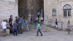 Jewish schoolkids wait for game of football (soccer) in old city Jerusalem Stock Footage