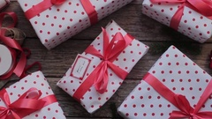 Holiday Gift Boxes on a Wooden Table Stock Footage