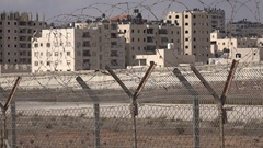Barbed wire and separation barrier, view towards Ramallah in West Bank Stock Footage