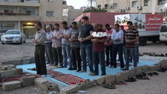 Muslims pray outside in makeshift mosque Aqaba, Jordan Middle East Stock Footage